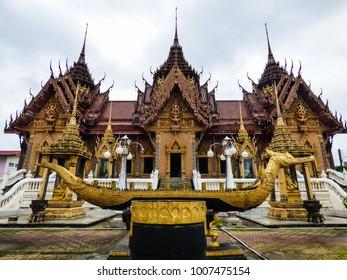 Golden dragon statue at Wat Khok Samankhun (Buddhist temple) in Hat Yai, Thailand