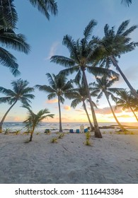 Golden dusk sun light at sunset on beautiful tropical beach with deckchairs at Lefaga, Matautu, Upolu Island, Western Samoa, South Pacific