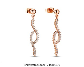 Golden earrings with crystals on white background, rose gold