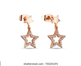 Golden earrings with crystals on white background, star shape, rose gold