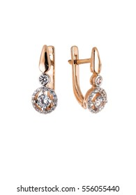 Golden earrings with diamonds isolated on white