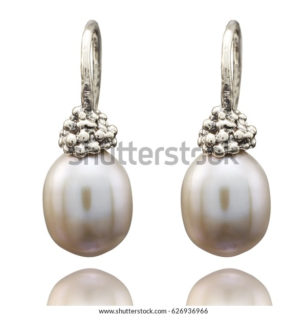 Golden earrings with gemstone isolated on white background.