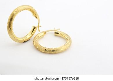 golden earrings isolated on white background