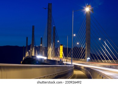 Golden Ears Bridge with traffic at night, motion blur. Between Langley and Maple Ridge, BC, Canada.