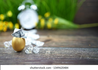 golden egg and diamond with dollars for business and easter concept
