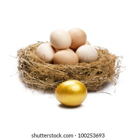 Golden egg in front of normal eggs puted in a nest. Isolated on white.