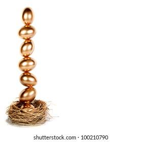 Golden eggs balance in a nest, financial metaphor, nest egg on white.