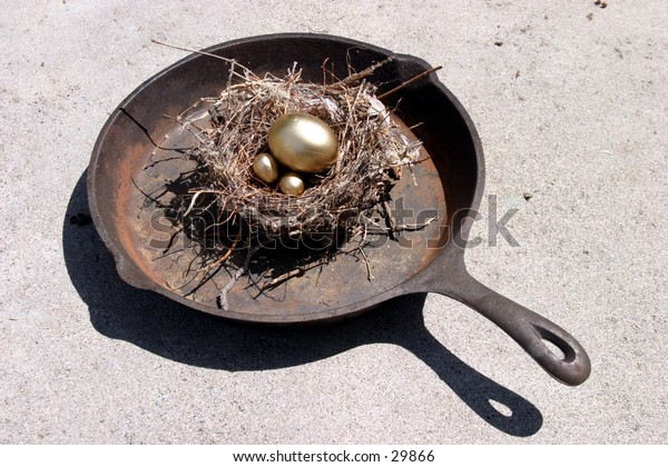 golden eggs in a bird nest in a frying pan representing finincial freedom and security in the image of a Nest Egg