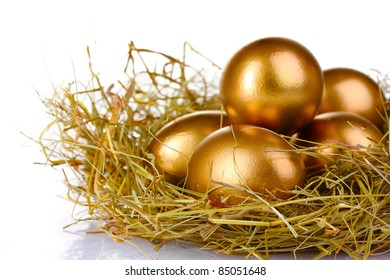 golden eggs in nest isolated on white