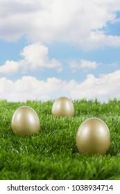 Golden eggs on green grass