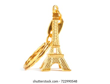 golden Eiffel tower keychain isolated on white