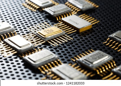 Golden electronic components close-up. Microelectronic conception.