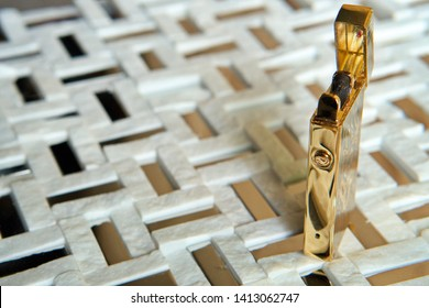 Golden electronic USB lighter on black and white background