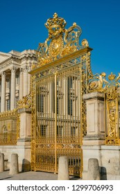 The golden entrance gate of the famous Palace of Versailles at France