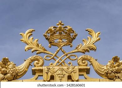 The golden entrance gate of the famous Palace of Versailles. Palace Versailles was a royal chateau. Versailles, Paris, France.