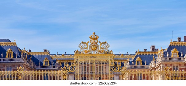 Golden Entrance Gates of the Palace of Versailles. Panoramic shot. Paris, France
