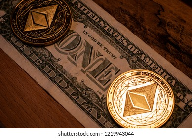 Golden Ethereum coins on a one Dollar bill with a dark wooden background.