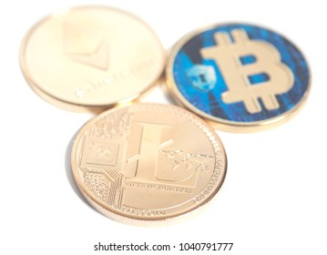 Golden Ethereum,Litecoin and Bitcoin on a white background