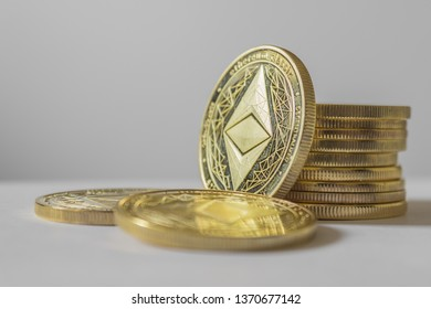 Golden Etherium coin close up on white background.