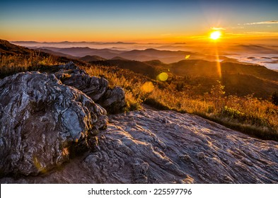 A golden fall sunrise over the Blue Ridge Mountains from atop Black Balsam Bald in North Carolina.