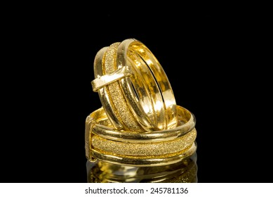 golden fancy rings with shadow isolated on black