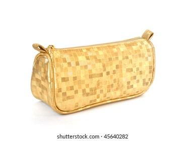 Golden female bag with corrugated surface without handle isolated on white background