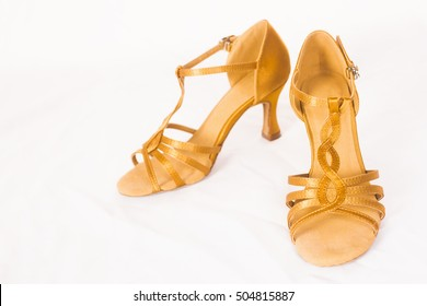 cfc853de9 Golden female dance shoes for latin dances on white background.