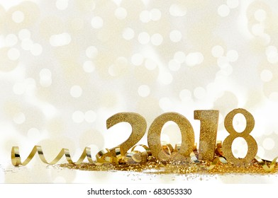 golden figures 2018 on glitter and bright bokeh background