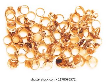 golden finger rings on white