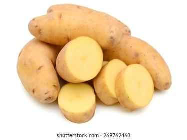 golden fingerling potatoes on white background