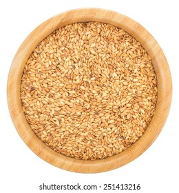 Golden flax seeds in wooden bowl isolated on white background. Flax seeds are rich in omega-3 fatty acid. Top view.