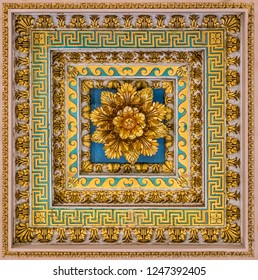 Golden floral decoration from the ceiling of the Basilica of Saint Paul Outside the Walls, in Rome. December-02-2018