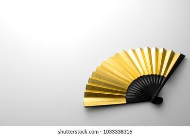A golden folding fan