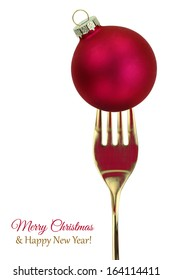 Golden fork with Christmas food ball isolated on white background