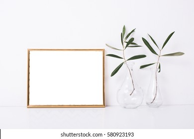 Golden frame mock-up on white wall