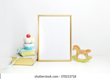 Golden Frame mockup. Place your work.  Horse and book with ice cream. Template print art, shabby style, white background.