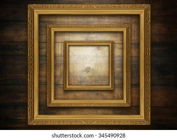 Golden frame on old wooden wall