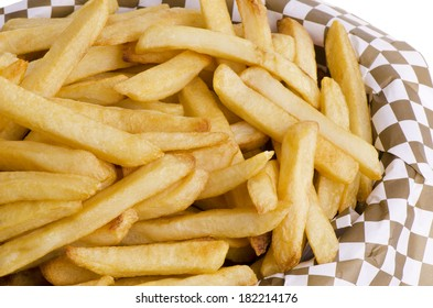 Golden french fries in basket, close up.
