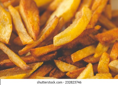 Golden French fries potatoes ready to be eaten. Slightly overcooked, that would be crispy