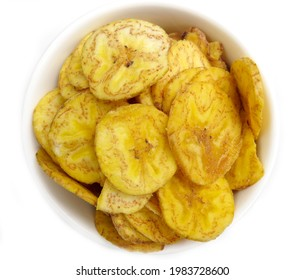 Golden fried plantain chips in a round white bowl
