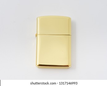 golden gasoline lighter with a wick on a white background.