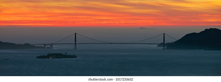 Golden Gate Bridge with Alcatraz Island in the fore ground and the Farallons in the background, San Francisco Bay at dusk as seen from the Berkeley hills