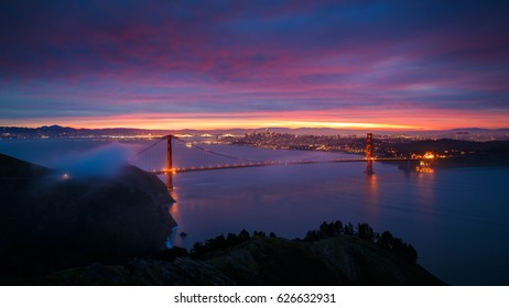 The Golden Gate Bridge and City of San Francisco at Sunrise with Dramatic Clouds
