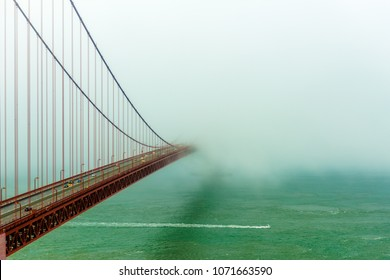 Golden Gate bridge disappearing off into the distance as the fog shrouds over it. Photo taken in San Francisco California