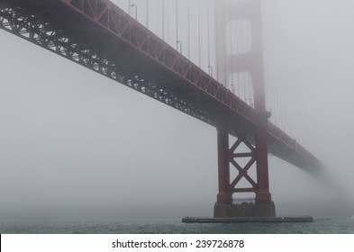 The Golden Gate Bridge disappears into the fog.