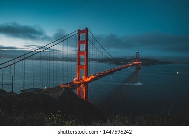 Golden Gate Bridge during sunrise with San Francisco in the background.