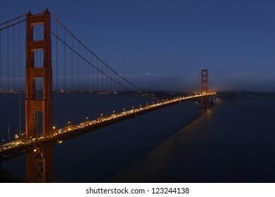 Golden Gate Bridge at dusk facing the city