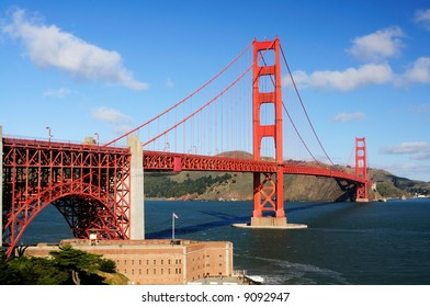 Golden Gate Bridge and Fort Point on a fine winter morning against a backdrop of blue sky with white clouds- landscape orientation.