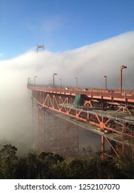 Golden Gate Bridge is getting surrounded by heavy fog while the legs of Golden Gate Bridge is still visible.