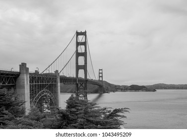 Golden Gate Bridge looking up with fog and landscape  view black and white